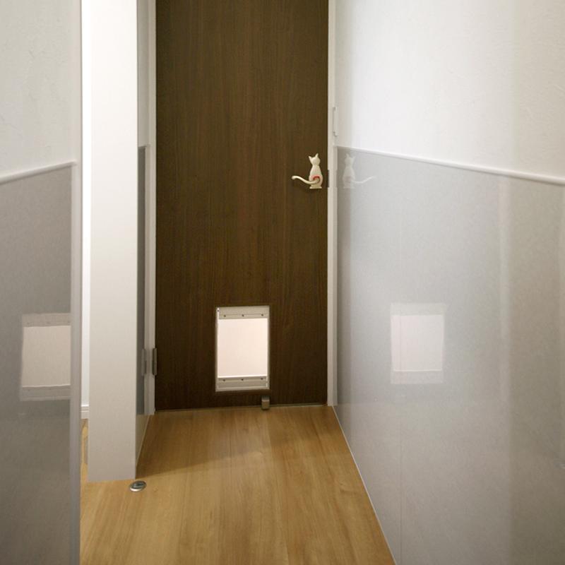 ドアの下部にはねこちゃん用出入り口